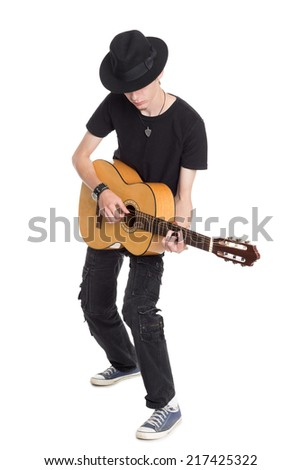 Young guitarist playing guitar, isolated on white.