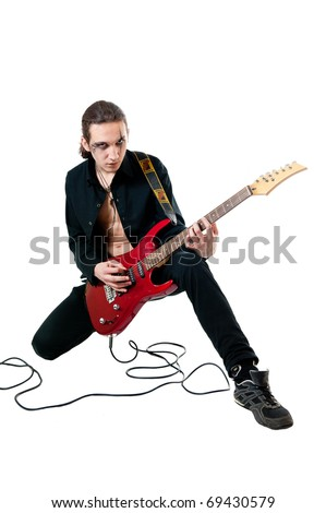 Young guitarist with red guitar on white background
