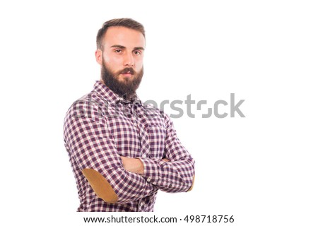 Young guy crossing his arms isolated on white background