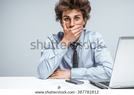 Young guy did not say a word!Student shocked what happened, looking at camera. - stock photo