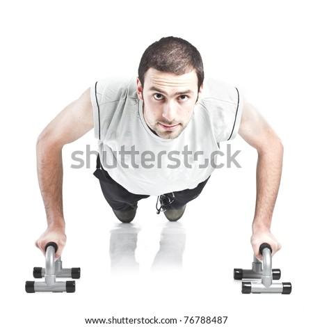 Young guy doing push ups isolated on white background - stock photo