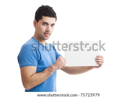 Young guy holding a blank bill board isolated on white background - stock photo