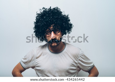 Young guy in black wig - stock photo