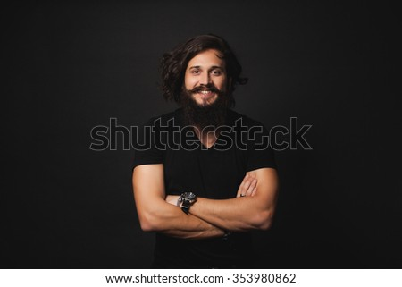 young guy in stylish fashionable clothes with beard and mustache brunette, brutal macho man posing in studio appearance - stock photo
