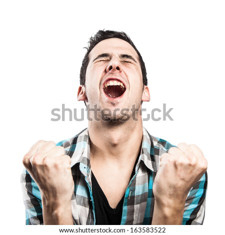 Young guy is celebrating a victory of his favorite team. - stock photo