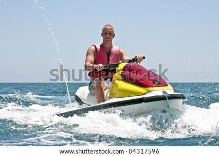 Young guy on a jet ski on the atlantic ocean