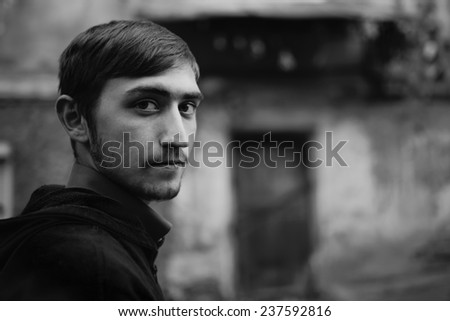 young guy on city street - stock photo