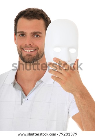 Young guy takes off white mask. All on white background. - stock photo