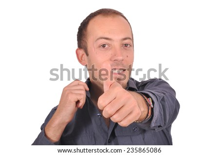 Young guy thumbs up - stock photo
