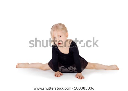 young gymnast doing the splits