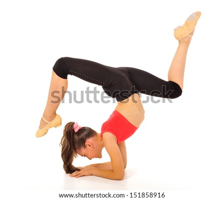 young gymnast in a sportwear on a white background.Sporting exercises.Aerobics.Flexibility.Plastic study.