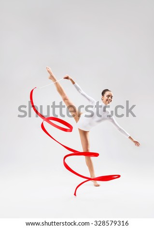 Young gymnast with tape in the studio
