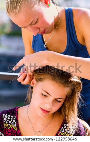 Young hairdresser girl at work