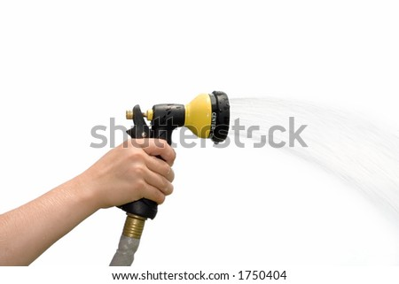 Young hand holding a spraying hose nozzle - stock photo