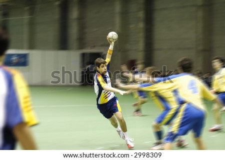 Young handball player in a match - stock photo