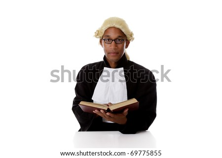 Young handsome African American judge man with a open book in hands, reading about justice. Studio shot. White background. - stock photo