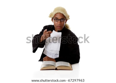 Young handsome African American judge man with a open book on reflective surface, pointing at camera. Studio shot. White background. - stock photo