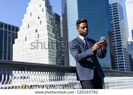 Young handsome african business man outside with the phone