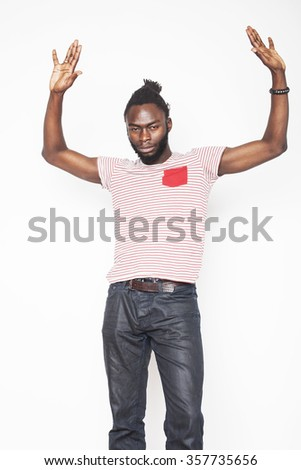 young handsome afro american boy in stylish hipster hat gesturing emotional isolated on white background smiling - stock photo