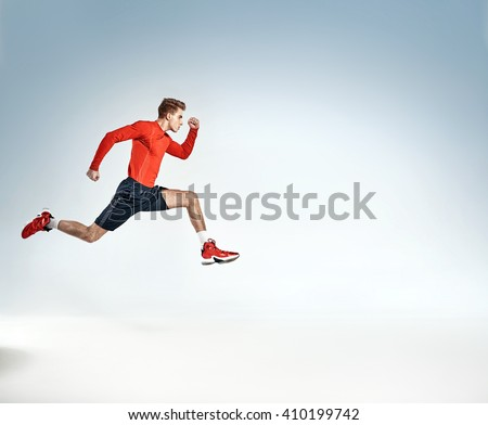 Young handsome athlete running