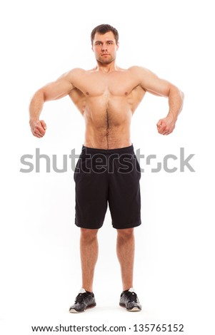 Young handsome bodybuilder isolated over white background