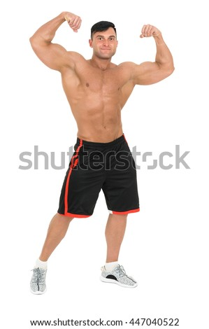 Young handsome bodybuilder man posing for fitness fashion shoot. Isolated on white background