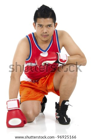 Young handsome boxer sitting over on white background. - stock photo