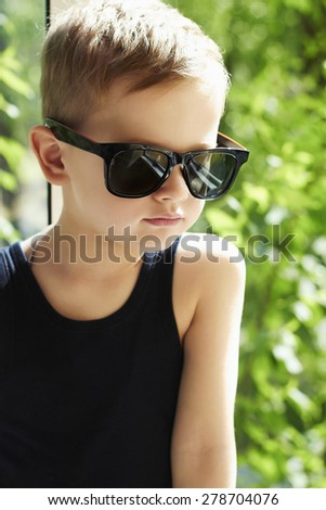young handsome boy in sunglasses.Outdoor fashion child - stock photo