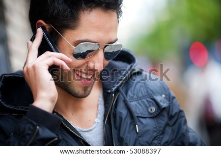Young handsome boy speaking on phone - stock photo