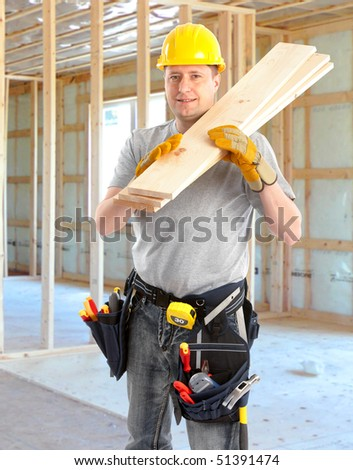 Young handsome builder with wood planks - stock photo