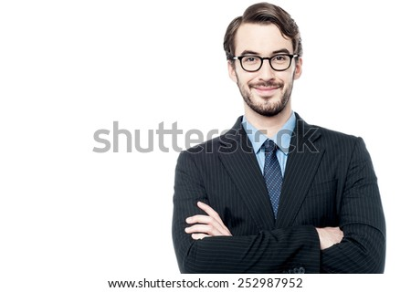 Young handsome business executive with folded arms. - stock photo
