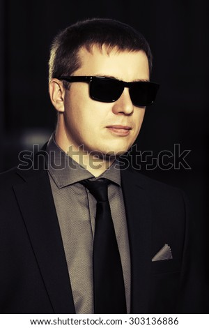 Young handsome business man in sunglasses - stock photo