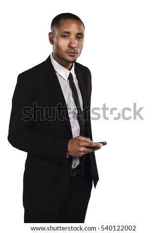 Young handsome business man looking at typing on mobile phone device isolated on white background