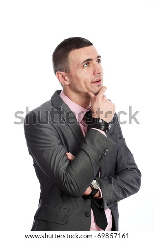 Young handsome business man looking up thoughtfully isolated on white background - stock photo