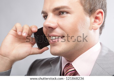 Young handsome business man making a phone call - stock photo