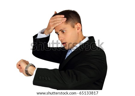 Young handsome business man running late and checking the time on his wrist watch - stock photo