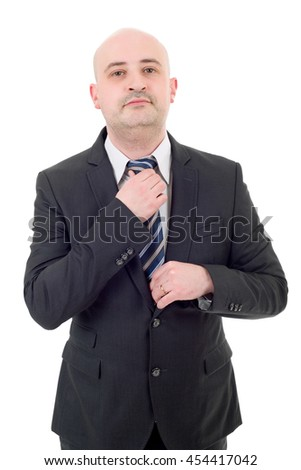 Young handsome businessman adjusts his tie, isolated - stock photo
