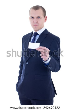 young handsome businessman in suit holding business card isolated on white background - stock photo