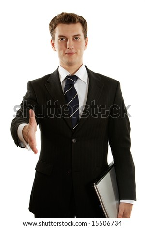 young handsome businessman offering the hand - stock photo