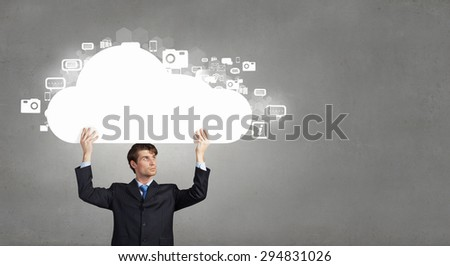 Young handsome businessman representing cloud computing concept - stock photo