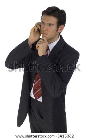 Young, handsome businessman. Talking by mobile phone. Wondering about something. Isolated on white in studio. - stock photo