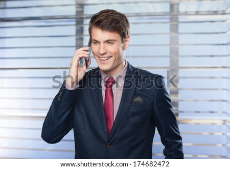 Young handsome businessman talking on the cell phone  - stock photo