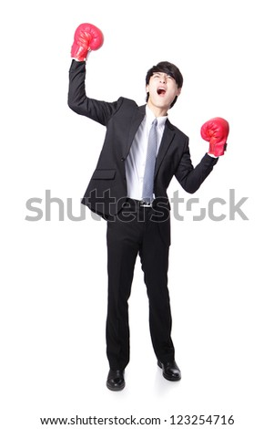 young handsome Businessman wearing boxing gloves in a victory pose and raise his arms in full length isolated on white background, asian model - stock photo