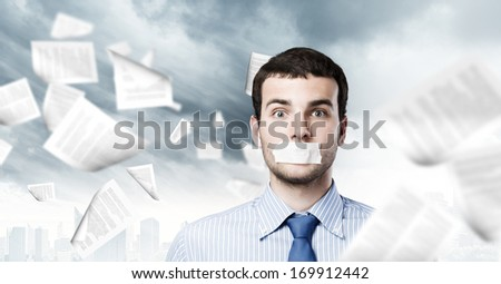 Young handsome businessman with adhesive tape on mouth - stock photo