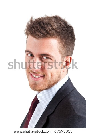 Young handsome businessman with green eyes isolated on white - stock photo