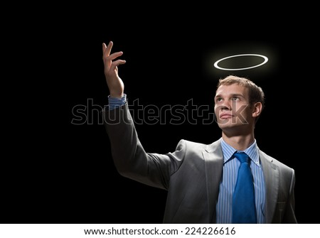 Young handsome businessman with halo above head - stock photo