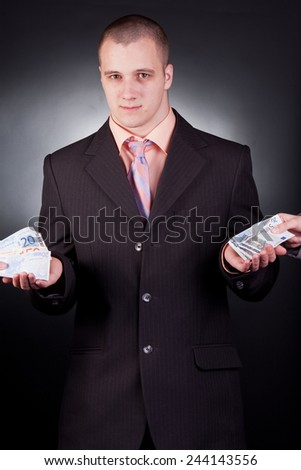 young handsome businessman with money - stock photo