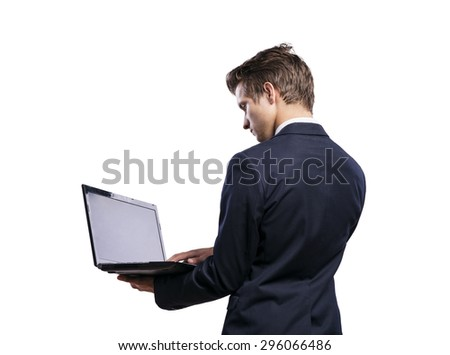 Young handsome businessman with notebook. Studio shot on white background.