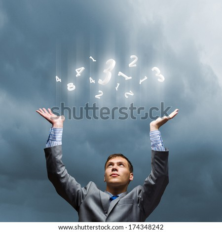 Young handsome businessman with numerals above head