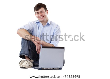 Young, handsome, casual man sitting with Computer at floor. Isolated on white background. - stock photo